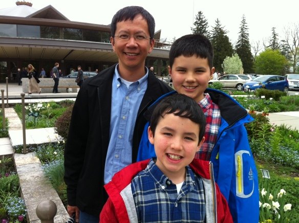 Adam Leung (right) with his brother, Josh, and dad outside the Festival Theatre